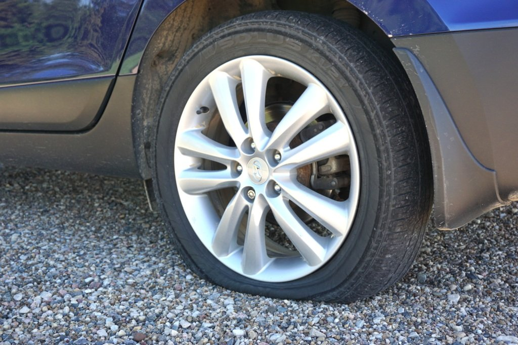 how to put air in flat tire